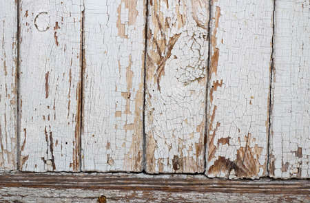 Old shabby wooden planks with cracked white color paint. Background. 免版税图像