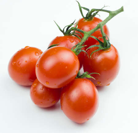 Close up view of red cherry tomatoes bunck on white background. Isolated tomatoes. Stock Photo