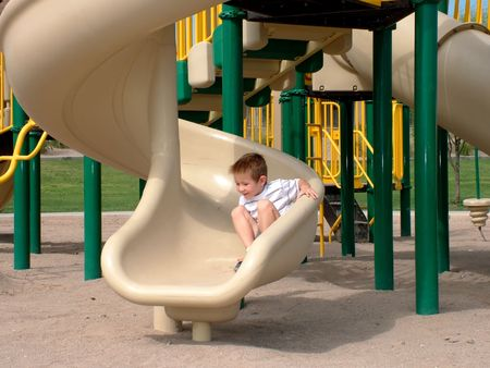 Little boy at the end of a slide Stock Photo - 284858