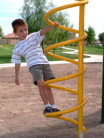 jungle gym: Little boy climbing a jungle Gym