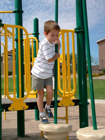 litle: Litle boy climbing on to pedistal