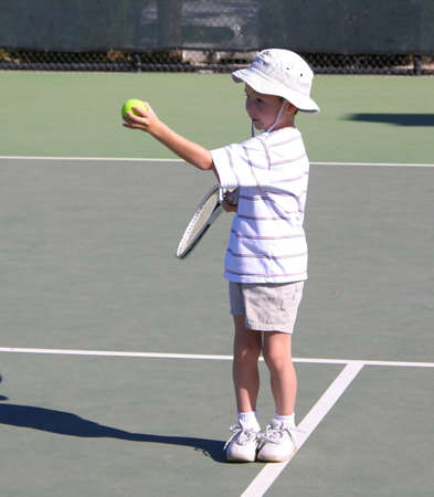 playing tennis: Boy Playing Tennis