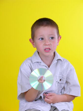 Boy spinning a CD on his finger photo