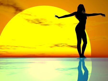 gracefully:  female silhouette gracefully against a sunset Stock Photo
