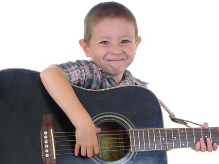 boy playing guitar: Boy playing an acoustic guitar
