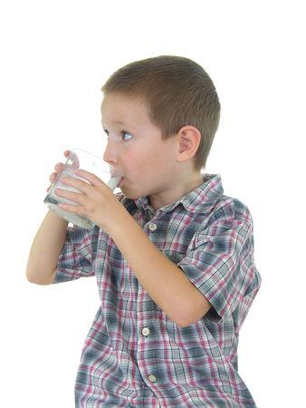 sip: Boy drinking a glass of milk Stock Photo
