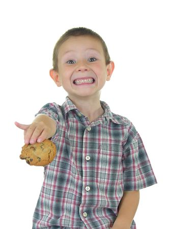 Boy offering a cookie