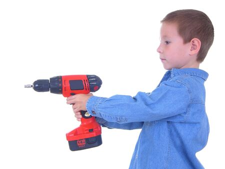 power drill: Boy with a power drill Stock Photo