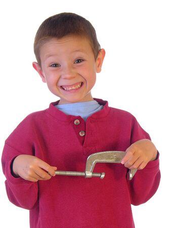 Boy tunrning a C-clamp