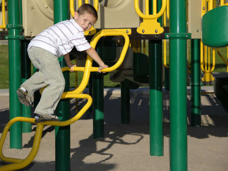 Boy climbing a playground ladder