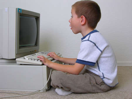 Surprised boy at computer photo