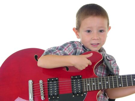 boy playing guitar: Boy playing electric guitar Stock Photo
