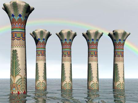 Egyptian pillars in the sea with rainbow