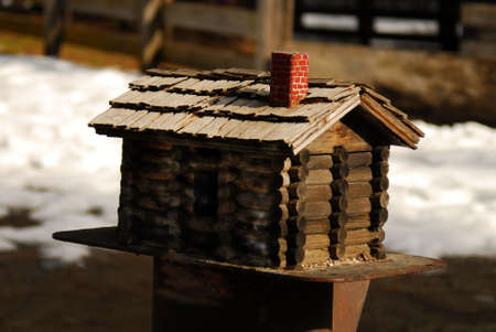 Log cabin bird house Stock Photo - 375567