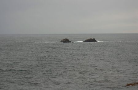 Coastal rocks during light storm