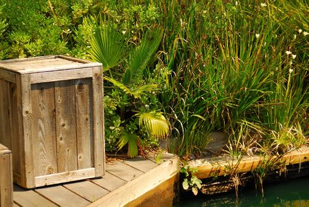 water's: Crate at waters edge Stock Photo