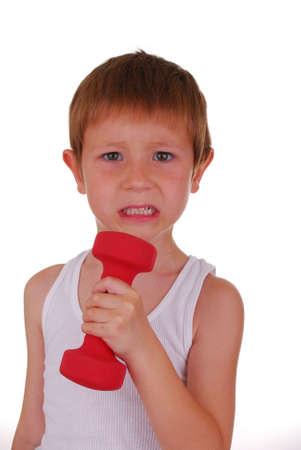 Boy lifting weights Pocket Hercules Banco de Imagens