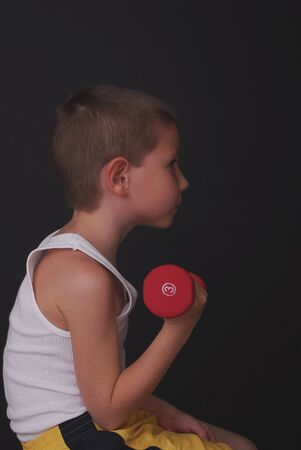 Young boy lifting weights pocket hercules