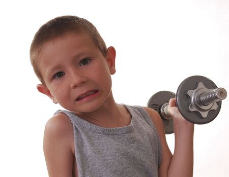 Young boy working out with weights pocket hercules Фото со стока