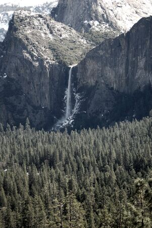 Waterfall in Yosemite Valley with muted tones