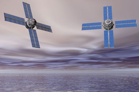Pair of satellites suspended over the sea