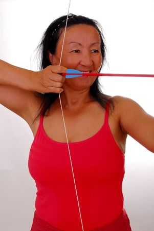 Lovely lady shooting a bow and arrow Stock Photo