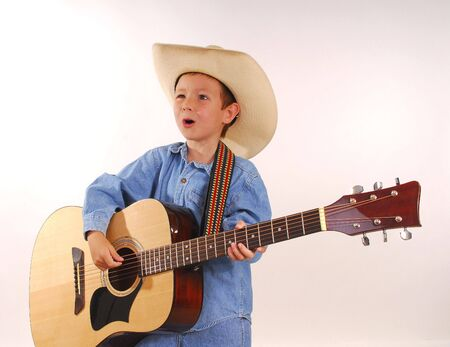 Young boy playing guitar photo
