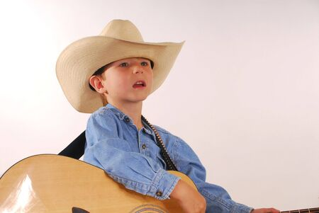 Young boy playing guitar photo