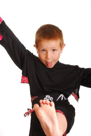 Young boy practicing his kung fu moves photo