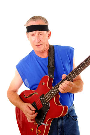 Senior rocking on an electric guitar photo