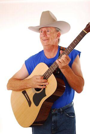 Senior rockin on an acoustic guitar photo