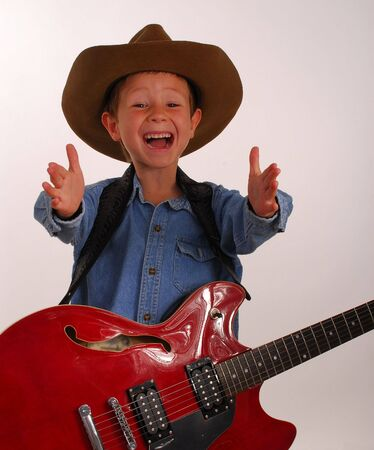 Young boy playing electric guitar