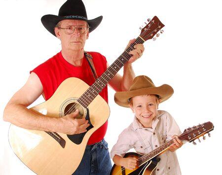 mandolino: Uomo e ragazzo che giocano guitar e mandolin Archivio Fotografico
