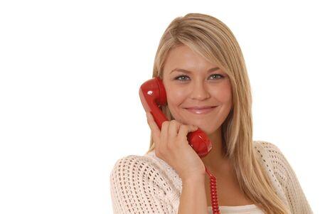 Lovely girl on standard telephone photo