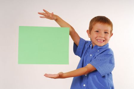 Boy magically holding sign floading in air
