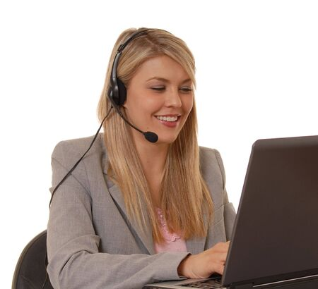telephonist: Business lady at computer with headset