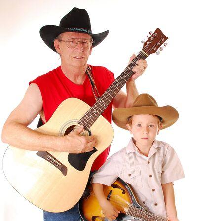 jamming: Man and boy playing guitar and mandolin