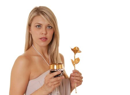 A lovely young girl with a glass of wine and a golden rose photo