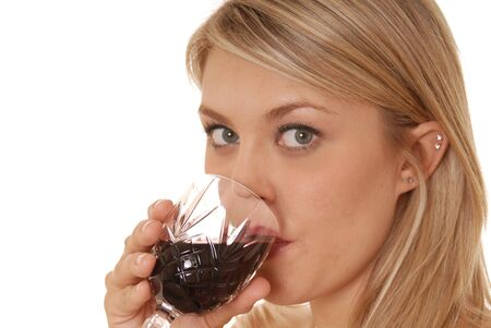 Lovely lady sipping a glass of wine photo