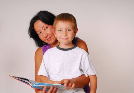 Mother reading to her son photo