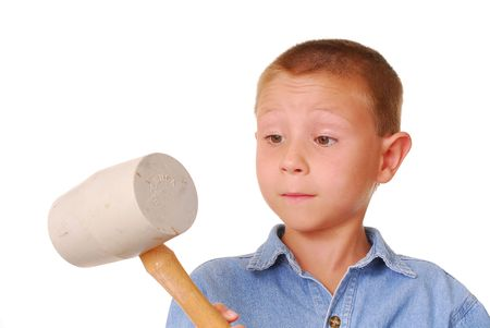 Young boy with a rubber mallet photo