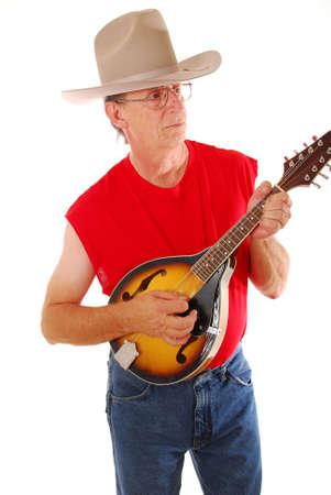 Senior rocking on an acoustic mandolin photo