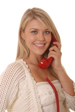 eyes hazel: Lovely girl on standard telephone Stock Photo