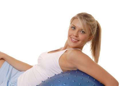 Lovely young girl working out with exercise ball photo