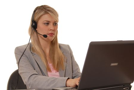 Business lady at computer with headset on