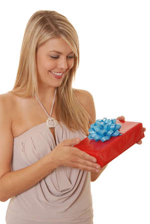 Lovely young girl opening gift photo