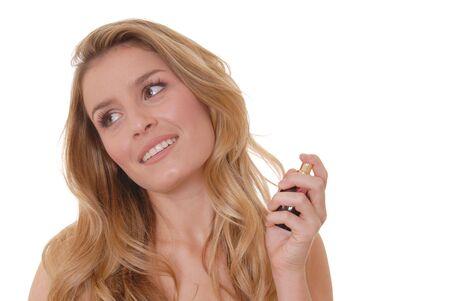 Lovely girl applying perfume Stock Photo