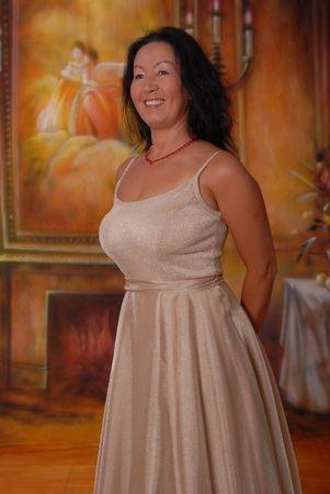 Beautiful lady in a warm setting Standard-Bild