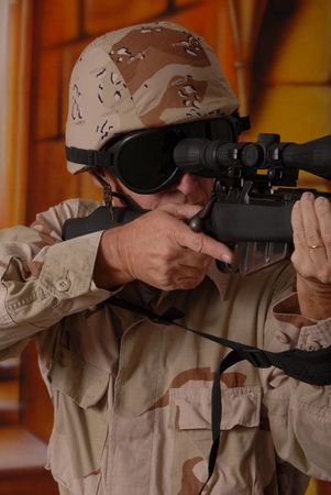 Camouflaged old soldier with sniper rifle inside building Stock Photo - 566248