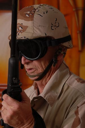 Camouflaged old soldier with sniper rifle inside building Stock Photo - 566251